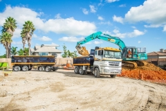 Scarbro Civil Contractors Excavator Loading Truck
